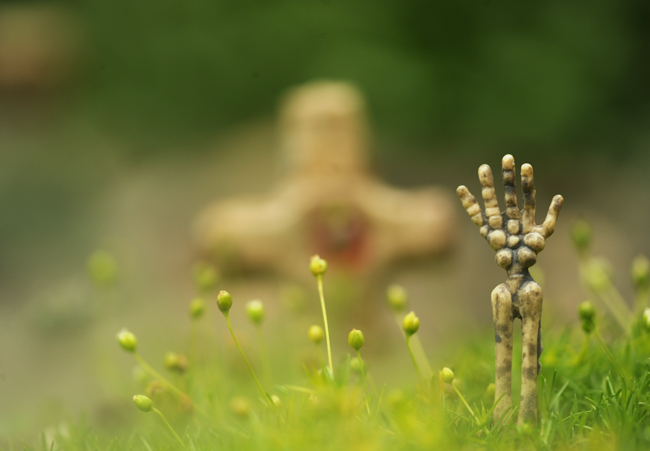 Hand in minature cemetery