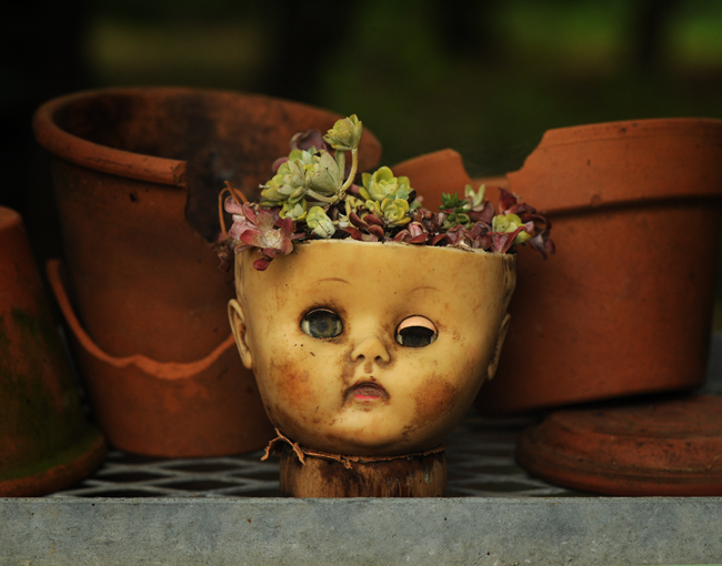Creepy doll planter