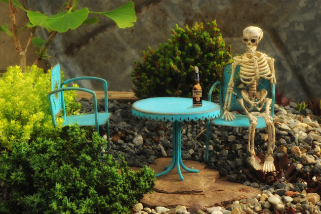 Skeleton seated with corona