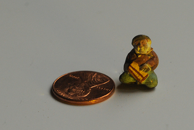 Small ceramic man for terrarium with penny