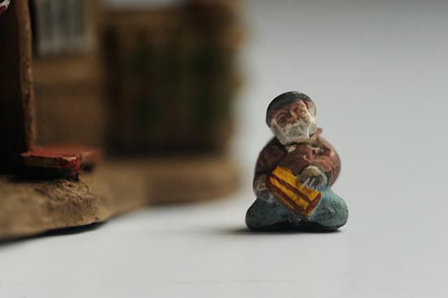Small ceramic man for terrarium