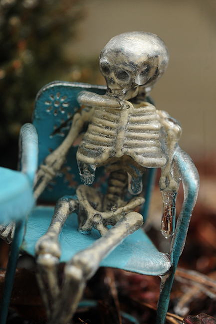 Skeleton in chair