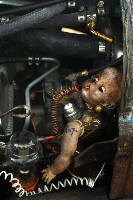 Doll baby in engine compartment