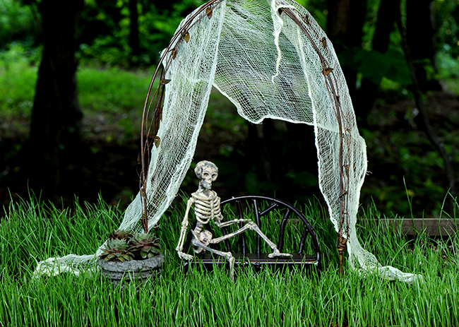 Skeleton on garden bench
