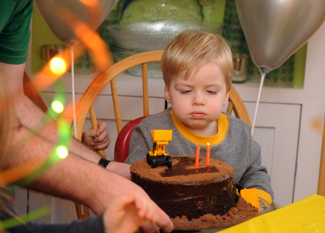 Quinn blowing out candles