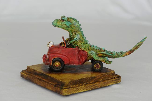 Rex driving a modified truck