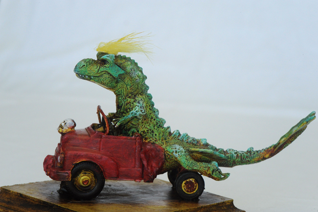 Assemblage Tyrannosaurus rex driving modified truck with Trump toupee