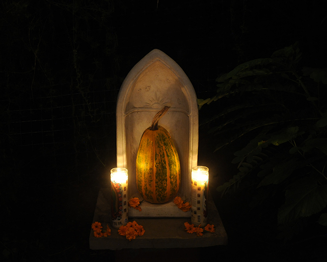 Shrine with pumpkin candles and marigolds