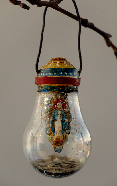 Assemblage light bulb ornament with Saint