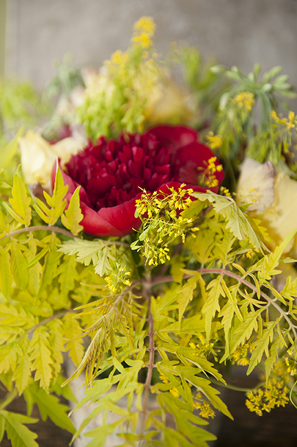 Flower arrangement with Peony 'Red Charm' and sumac 'Tiger Eye'