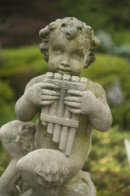 Cherub playing reed pipe at Hillwood