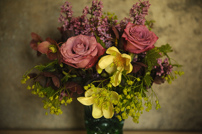 Flower arranement with maple magnolia rose helleborus and lilac