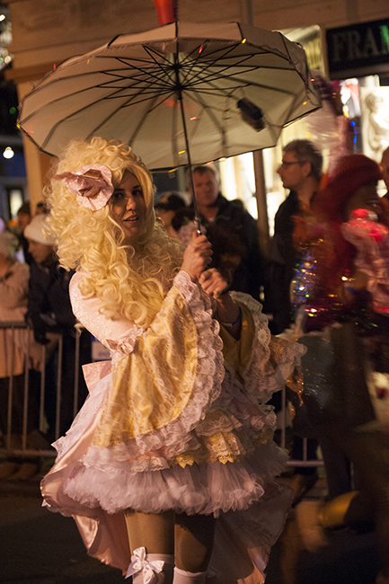 Girl with umbrella in Krewe parade