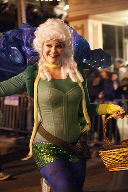 Lady in green in Krewe parade