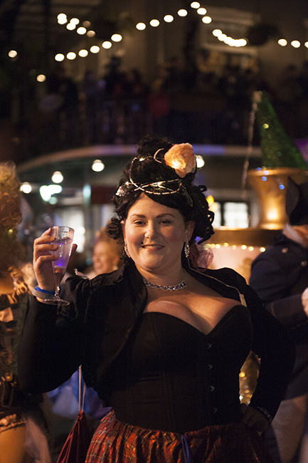 Young lady in black in Krewe parade