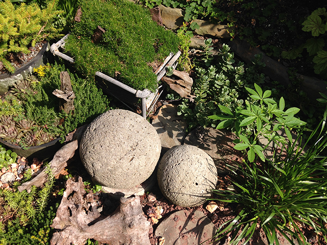 Cement sphere's in Peggy Bier's garden