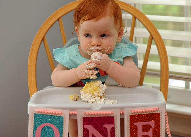 Juniper eating a cupcake on her first birthday