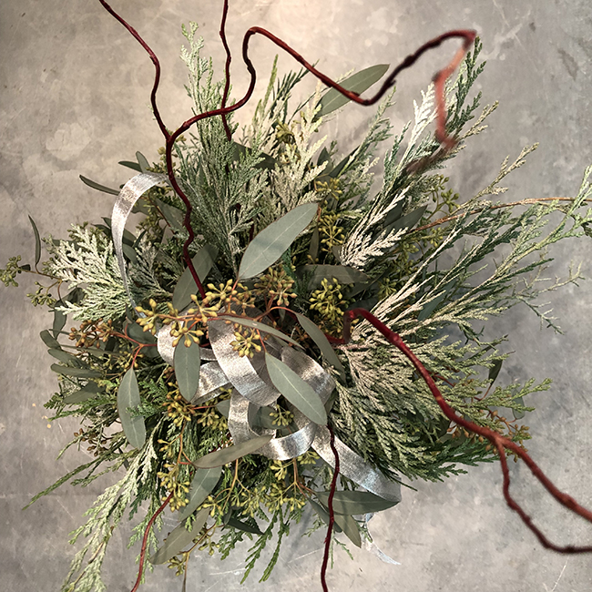 Flower arrangement with eucalyptus cedar and corkscrew willow
