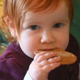 June Bug at one and a half eating cookie