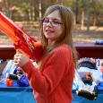Felicity with a Nerf gun