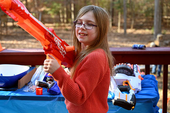 Felicity with a Nerf gun
