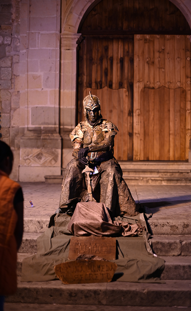 Gold man street performer in Oaxaca