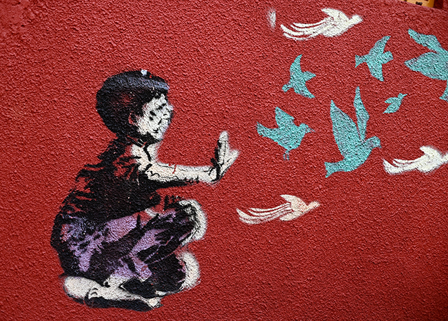 Street art releasing birds