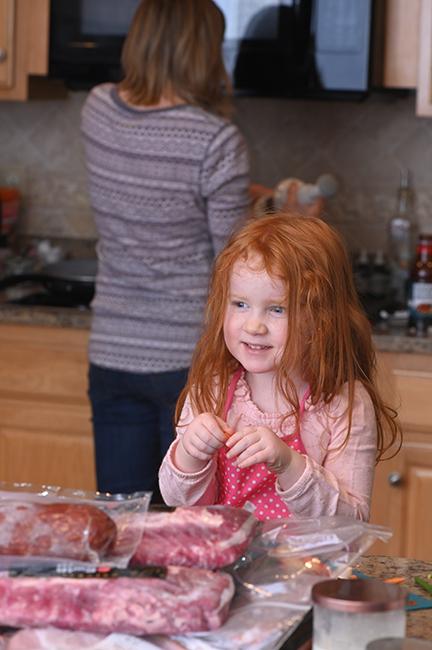 Juniper helping in kitchen