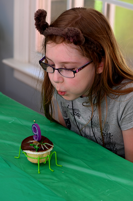 Felicity blows out candle