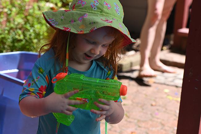 Juniper with a watergun