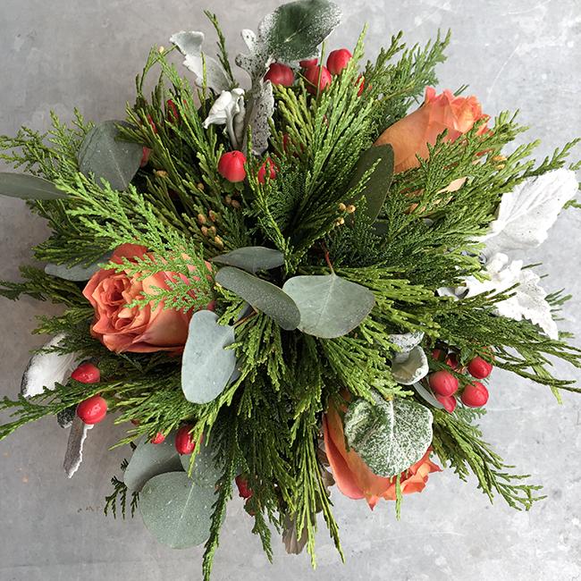 Flower arrangement roses and hypericum berry