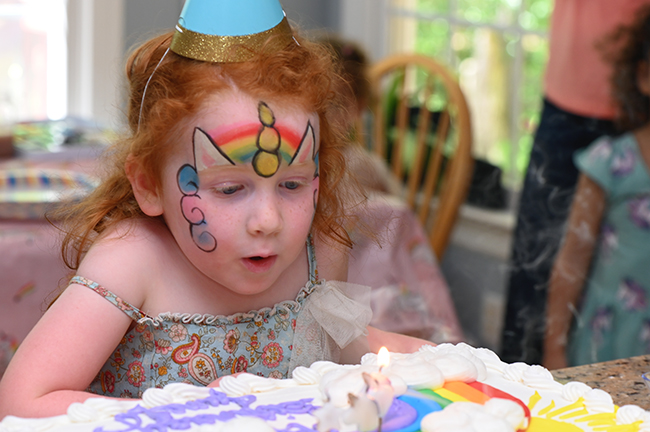 Juniper blowing out her candles