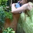 Felicity taking care of fairy gardens