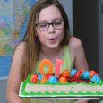 Felicity blowing out candles 10th birthday party