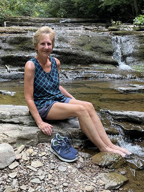 Kim with feet in creek